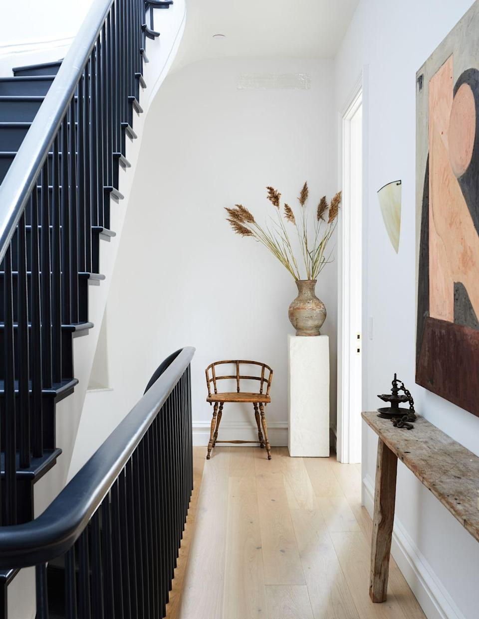 """<p><em>EyeSwoon</em>'s Athena Calderone makes the most of every square inch of <a href=""""https://www.veranda.com/luxury-lifestyle/books-to-read/g32601137/athena-calderone-eyeswoon-house/"""" rel=""""nofollow noopener"""" target=""""_blank"""" data-ylk=""""slk:her Cobble Hill townhouse"""" class=""""link rapid-noclick-resp"""">her Cobble Hill townhouse</a>, including the stairway. Black-painted stairs and bannister, white walls, and a collection of vintage and antique finds make this space yet another soothing and inspiring vignetter in her home.</p>"""
