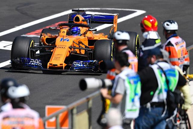 McLaren's Fernando Alonso was again behind the pace-setters in the opening practice sessions ahead of the French Grand Prix. (AFP Photo/GERARD JULIEN)