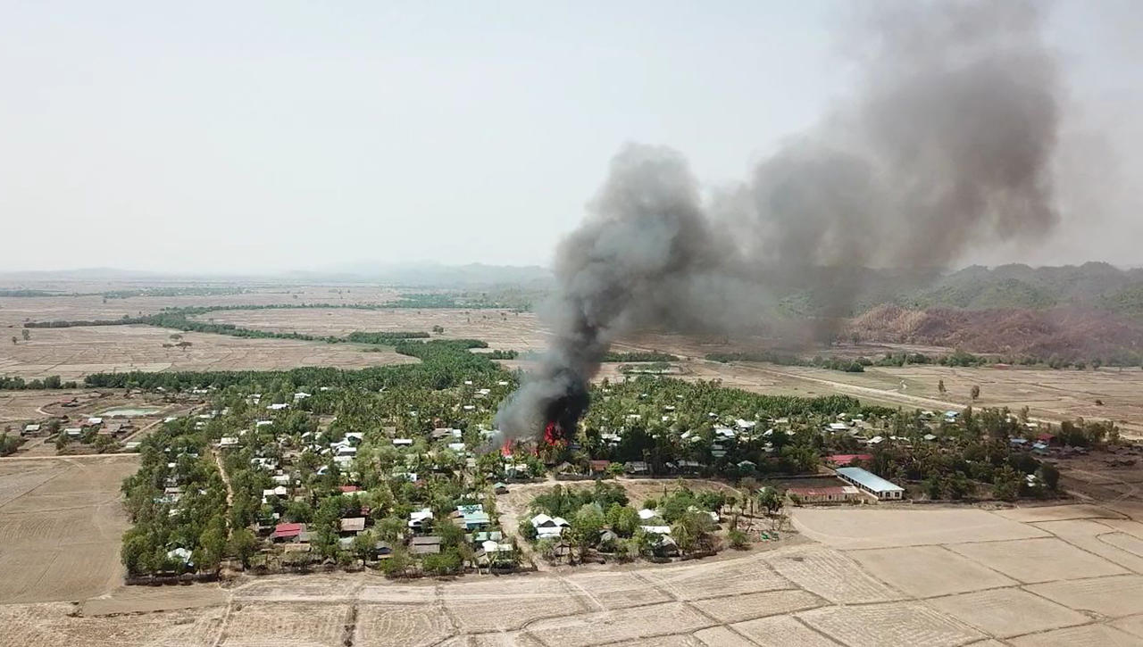 Rights group: Satellite images show Myanmar village burning