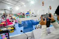 A doctor works in the intensive care unit (ICU) of the Ayeyarwady Covid Center at the Wunna Theikdi football stadium in Mandalay, amid the ongoing Covid-19 coronavirus pandemic