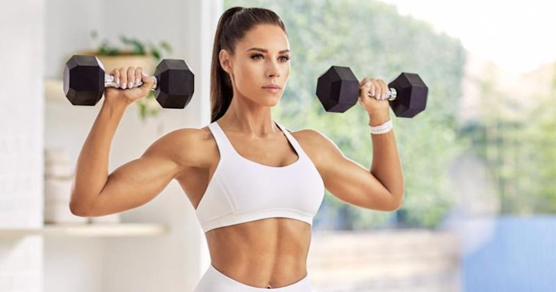 All You Need Is a Set of Dumbbells to Crush This Arms and Abs Workout By Kelsey Wells