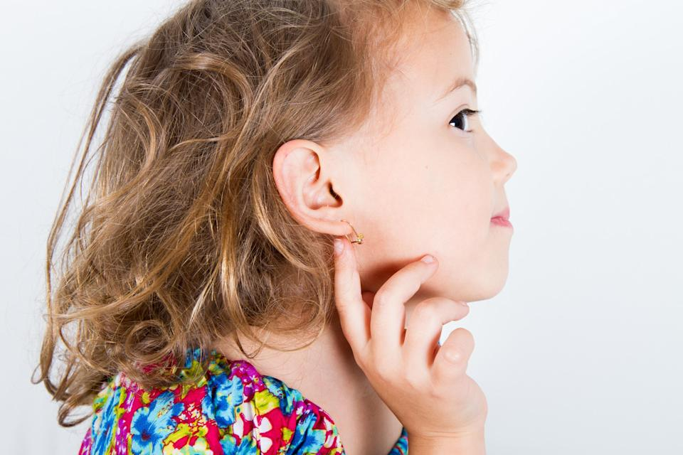 Do you think it's ok to get your child's ears pierced at age four? [Photo: Getty]