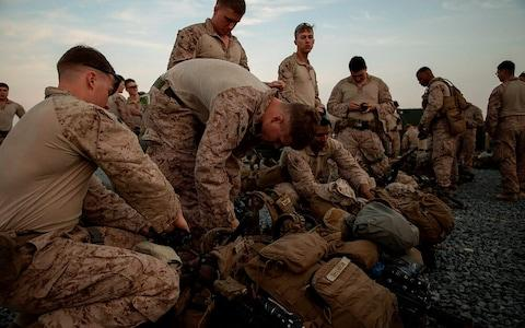<span>US Marines assigned to Special Purpose Marine Air-Ground Task Force prepare to deploy from Kuwait in support of a crisis response mission</span> <span>Credit: U.S. Marine Corps photos by Sgt. Robert G. Gavaldon via AP </span>