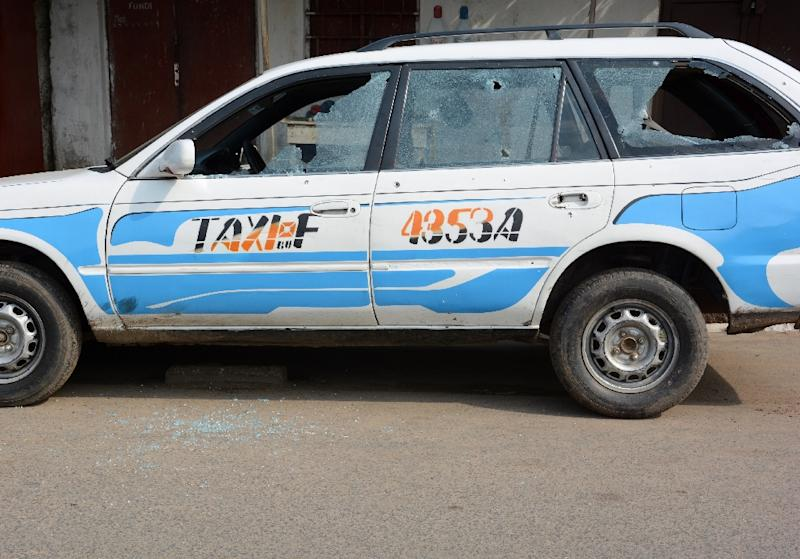 A taxi's windows are shattered in the attack in Bujumbura that left a child dead and 30 people wounded (AFP Photo/)