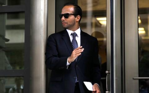 George Papadopoulos, former foreign policy adviser to Donald Trump, left the federal court in Washington after being sentenced to 14 days in prison for lying to the FBI. His claims that Britain and Australia had colluded with the FBI were the start of the Mueller probe into Russian interference in the US - Credit: AP Photo/Jacquelyn Martin