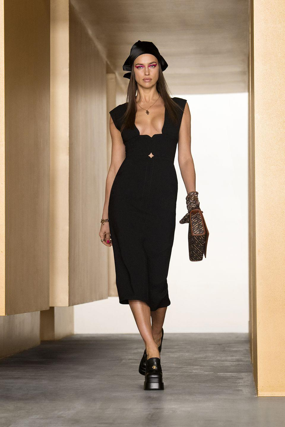 <p>Gigi Hadid returned to the runway for Donatella Versace's Fall 2021 presentation this morning, which showcased slim silhouettes, sharp tailoring, and sultry riffs on power dressing. The looks felt like veritable suits of armor, making their way through the season's Versace maze, inspired by the Greek Key. That La Greca code was combined with the brand's signature logo into a motif that echoed throughout the collection, alongside sultry cuts, mod minis, and eveningwear that will resonate with fashion renegades and red carpet frequenters alike. This season featured a rebellious spirit with looks that felt strong, powerful, and bold, but also pieces that were easy-to-wear, perfect for throwing on post-lockdown to take to the streets by day, or out for a sexy night on the town. <em>—Carrie Goldberg</em></p>