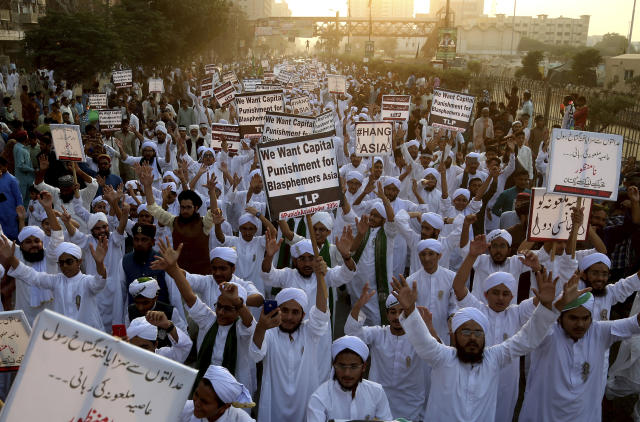 FILE - In this Nov. 21, 2018 file photo, Pakistani religious students rally for the implementation of a blasphemy law and against the acquittal of Aasia Bibi, in Karachi, Pakistan. In Mid January 2019, Bibi, a Pakistani Christian woman, still lives the life of a prisoner, although she was freed from death row by the country's top court more than two months ago. Meanwhile, a petition by Islamist radicals who rallied against her acquittal of blasphemy charges and who seek her execution awaits a Supreme Court decision. (AP Photo/Shakil Adil, File)