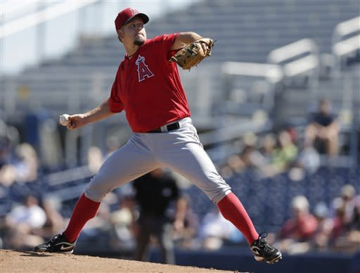 Los Angeles Angels starting pitcher Joe Blanton throws to a San Diego Padres batter during the first inning of a spring training baseball game Wednesday, March 13, 2013, in Peoria, Ariz. (AP Photo/Gregory Bull)
