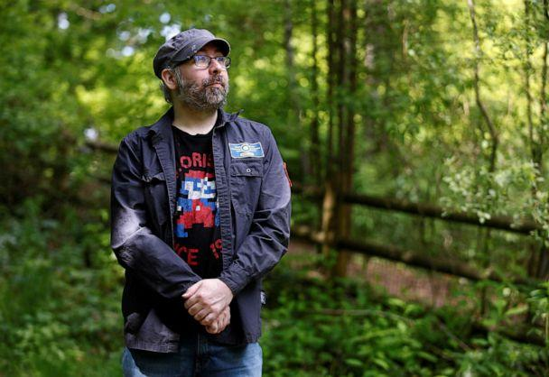PHOTO: Bret Chiafalo, a plaintiff in a case before the U.S. Supreme Court on 'faithless electors' poses for a photo at Lake Stickney Park near his home in Lynnwood, Wash., May 9, 2020. (Lindsey Wasson/Reuters)