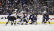 Winnipeg Jets and Vegas Golden Knights battle in front of Jets goaltender Laurent Brossoit (30) during the second period of an NHL hockey game Tuesday, Jan. 15, 2019, in Winnipeg, Manitoba. (Trevor Hagan/The Canadian Press via AP)