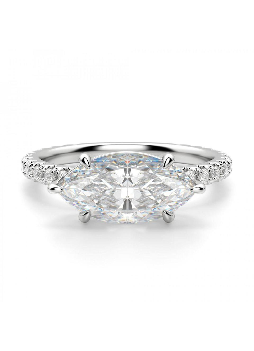 """""""Surprisingly, round stones are our least popular shape,"""" Nicholson says. If that tracks for you, this design brings in two trending engagement ring styles: a marquise-cut and east-west setting. $1470, Diamond Nexus. <a href=""""https://www.diamondnexus.com/east-west-accent-marquise-engagement-ring.html"""" rel=""""nofollow noopener"""" target=""""_blank"""" data-ylk=""""slk:Get it now!"""" class=""""link rapid-noclick-resp"""">Get it now!</a>"""