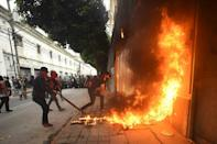Demonstrators set on fire part of the Congress building in Guatemala City