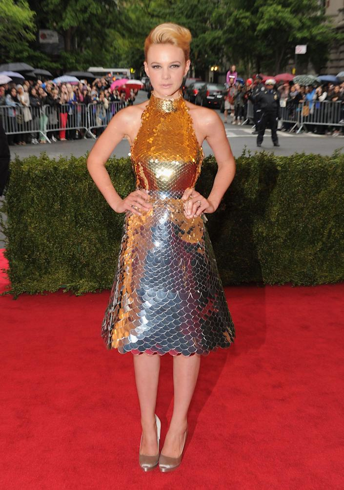 carey mulligan wearing a gold and silver dress at the met gala in 2012