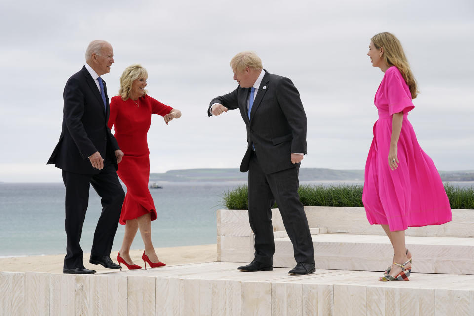 President Joe Biden and first lady Jill Biden are greeted by British Prime Minister Boris Johnson and his wife Carrie Johnson before posing for photos at the G-7 summit, Friday, June 11, 2021, in Carbis Bay, England. (AP Photo/Patrick Semansky, Pool)