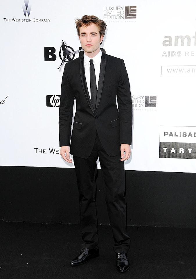 """""""Twilight"""" heartthrob Robert Pattinson auctioned off two kisses that sold for $28,000 each! Tony Barson/<a href=""""http://www.wireimage.com"""" target=""""new"""">WireImage.com</a> - May 21, 2009"""