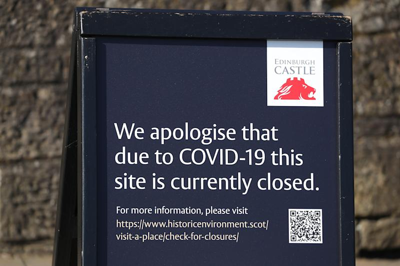 A sign outside Edinburgh Castle which is closed due to coronavirus as the UK's death toll reached 144 as of 1pm on Thursday.