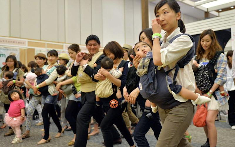 Women are still often expected to give up work after having children in Japan - AFP