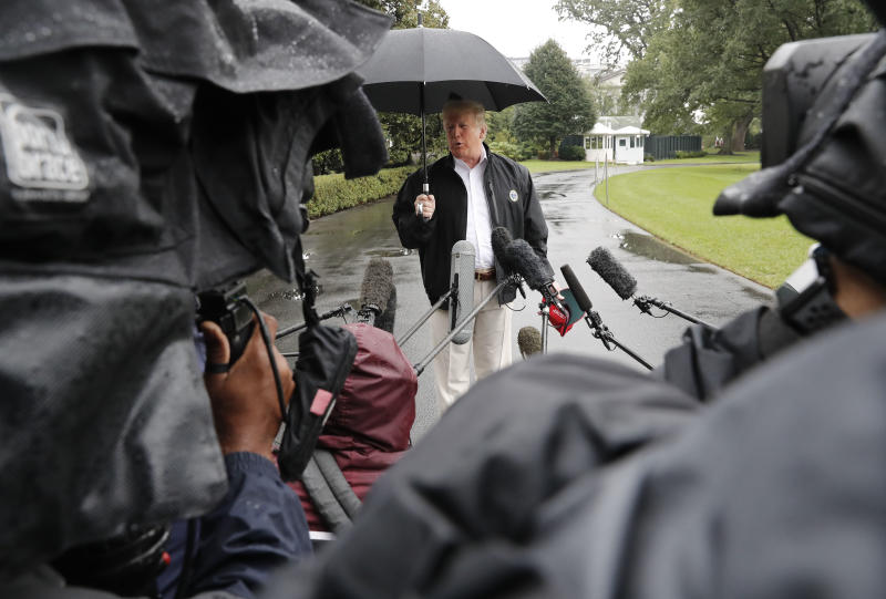President Donald Trump stops to talk to members of the media before walking across the South Lawn of the White House in Washington, Monday, Oct. 15, 2018, to board Marine One helicopter for a short trip to Andrews Air Force Base, Md., en route to Florida to tour areas the devastation left behind from Hurricane Michael last week. (AP Photo/Pablo Martinez Monsivais)