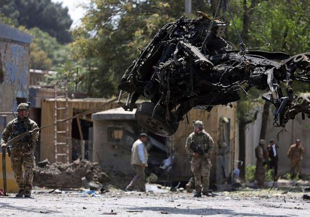 PHOTO: Resolute Support (RS) forces remove a damaged vehicle after a car bomb explosion in Kabul, Afghanistan, Sept. 5, 2019. A car bomb exploded near a neighborhood housing the U.S. Embassy in Kabul. (Rahmat Gul/AP)