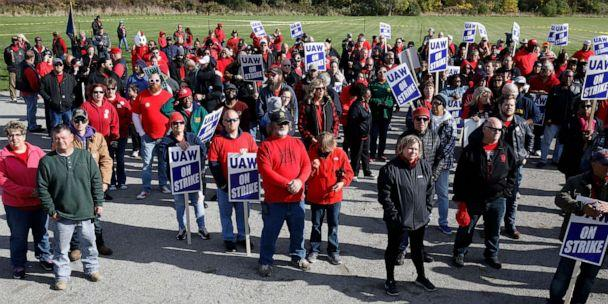PHOTO: United Auto Workers union members and their families rally near the General Motors Flint Assembly plant on Solidarity Sunday on Oct. 13, 2019, in Flint, Michigan. (Bill Pugliano/Getty Images)