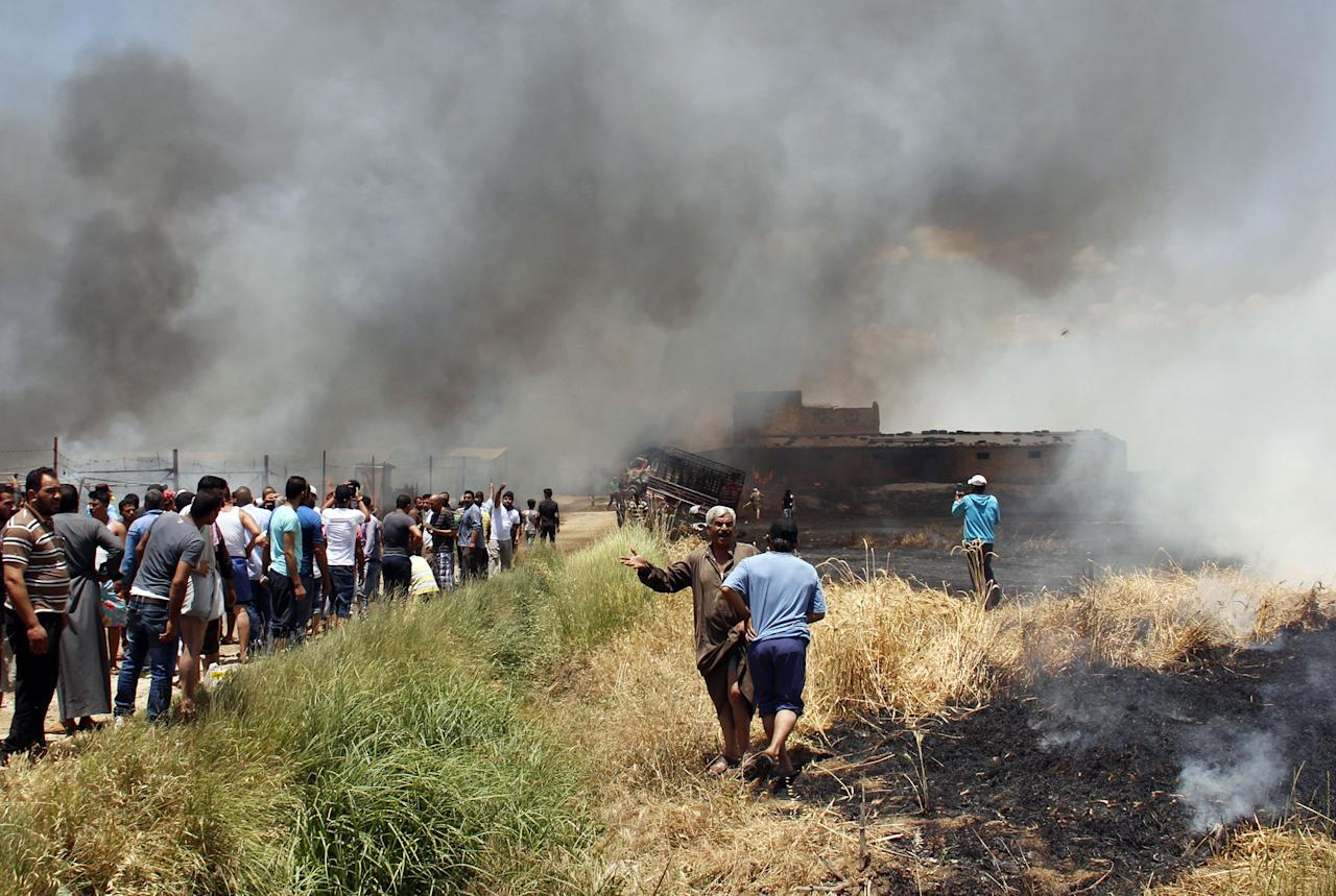 <p>Smoke billows as Syrians refugees attempt to extinguish a massive fire in a camp for refugees near the village of Qab Elias in the Lebanese Bekaa valley on July 2, 2017.<br /> A massive fire in a camp for Syrian refugees in central Lebanon killed one person and wounded six others, the Red Cross said, adding that hundreds were evacuated. (Hassan Jarrah/AFP/Getty Images) </p>