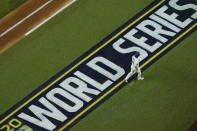 Los Angeles Dodgers' Will Smith walks to the dugout after striking out against the Tampa Bay Rays during the second inning in Game 1 of the baseball World Series Tuesday, Oct. 20, 2020, in Arlington, Texas. (AP Photo/David J. Phillip)