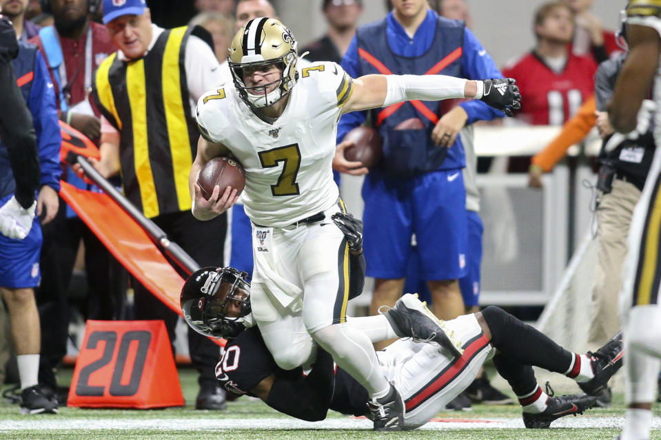 Nov 28, 2019; Atlanta, GA, USA; New Orleans Saints quarterback Taysom Hill (7) runs after a catch against the Atlanta Falcons in the first half at Mercedes-Benz Stadium. Mandatory Credit: Brett Davis-USA TODAY Sports