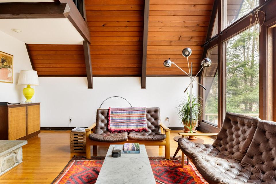 "<p>The hosts of this A-frame, built in the 1960s in New York's <a href=""https://www.cntraveler.com/gallery/where-new-yorkers-can-go-for-the-perfect-weekend-escape-this-summer?mbid=synd_yahoo_rss"" rel=""nofollow noopener"" target=""_blank"" data-ylk=""slk:Hudson Valley"" class=""link rapid-noclick-resp"">Hudson Valley</a>, leaned in to the mid-century modern theme—and we're not complaining. Filled with great antiques, the home offers two bedrooms, two bathrooms, an indoor fireplace, and all the perks that come with being an <a href=""https://www.cntraveler.com/story/airbnb-plus-is-for-people-who-hate-airbnb?mbid=synd_yahoo_rss"" rel=""nofollow noopener"" target=""_blank"" data-ylk=""slk:Airbnb Plus"" class=""link rapid-noclick-resp"">Airbnb Plus</a>, which means it's been vetted IRL by an Airbnb rep and comes with strong Wi-Fi, air-conditioning, a washer/dryer, comfortable mattresses, a coffee maker, and toiletries like shampoo. Outside, you'll find a grill, deck, and fire pit for when it gets really chilly. Note: Like most A-frames, there are stairs to the upstairs loft, but in this cabin there are also stairs to enter, making it more difficult for those with accessibility concerns to maneuver.</p> <p><strong>Book now:</strong> <a href=""https://airbnb.pvxt.net/qXDML"" rel=""nofollow noopener"" target=""_blank"" data-ylk=""slk:From $318 per night, airbnb.com"" class=""link rapid-noclick-resp"">From $318 per night, airbnb.com</a></p>"