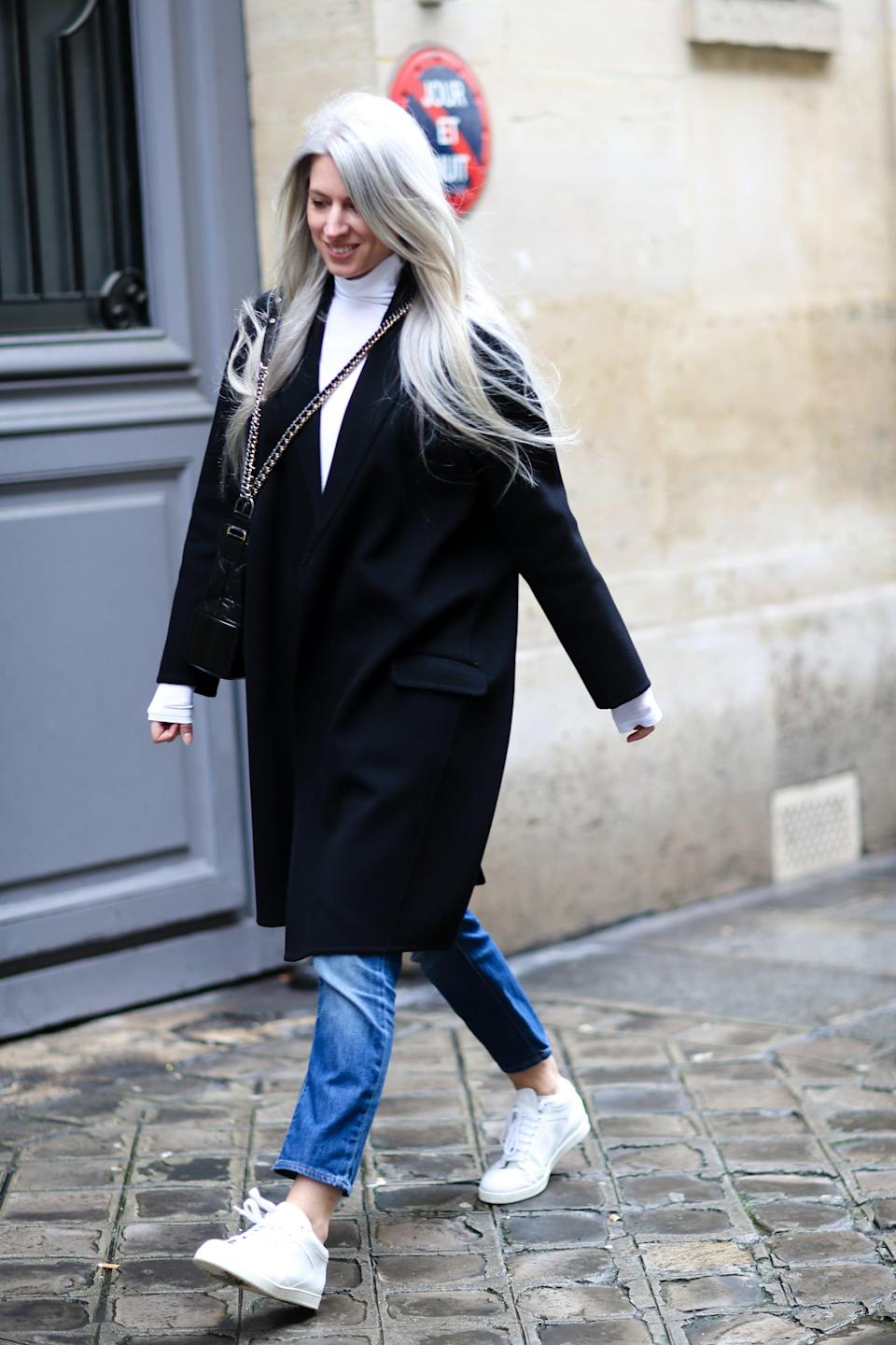 <p>Universally flattering, straight-leg jeans pair well with low-top sneakers of any kind. We're partial to black and white pieces with medium wash blue jeans for a timeless look. </p>