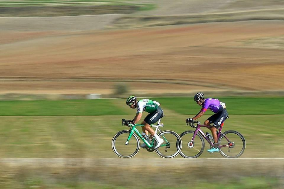 A couple of cyclists ride during the 9th stage of the 2020 La Vuelta cycling tour of Spain a 1577km race from Castrillo del Val to Aguilar de Campoo on October 29 2020 Photo by ANDER GILLENEA  AFP Photo by ANDER GILLENEAAFP via Getty Images