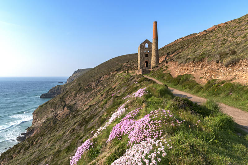 An old tin mine near chapel porth at South West Coast Path [Photo: Getty]
