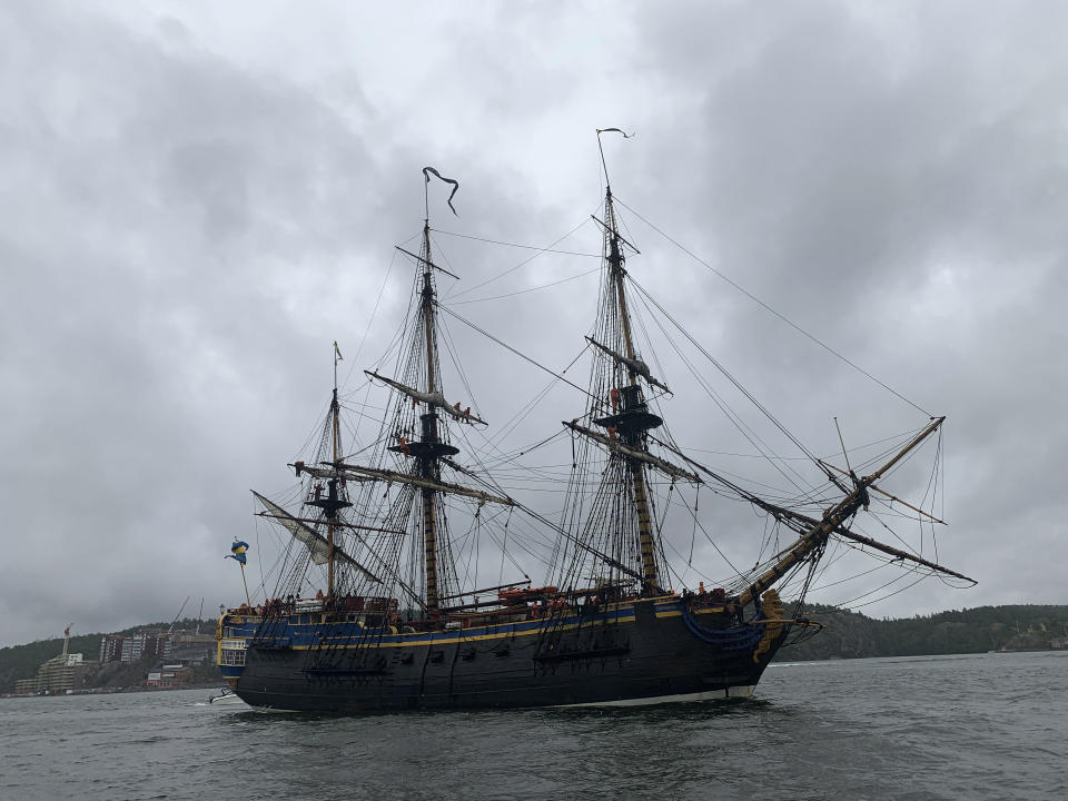 A full-size replica of a 18th century, three-mast, ocean-going wooden tall galleon that sank in 1745, enters Stockholm on Thursday, Aug. 26, 2021 on its first stop on its second journey to Asia that the ship will make next year. In 1745, the original merchant ship that had more than 130 men on board, ran aground and sank outside her home port of Goteborg, Sweden's second largest city, as it approached the harbor as it returned from its third voyage to China. (AP Photo/David Keyton)