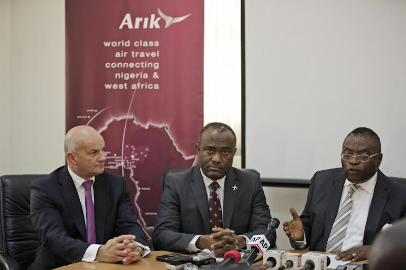 Vice chairman Arik Air Nigeria, Senator Aniete Okon, right, managing director, Chris Ndulue, center, and Rob Thomas third left, speak to journalist during a press conference in Lagos, Nigeria. Thursday, Sept. 20, 2012. Nigeria's largest airline Arik Air Ltd. halted all its domestic flights indefinitely Thursday as its leaders alleged government corruption made it impossible for the carrier to fly, after officials raided and disrupted its flights without explanation.(AP Photo/Sunday Alamba)