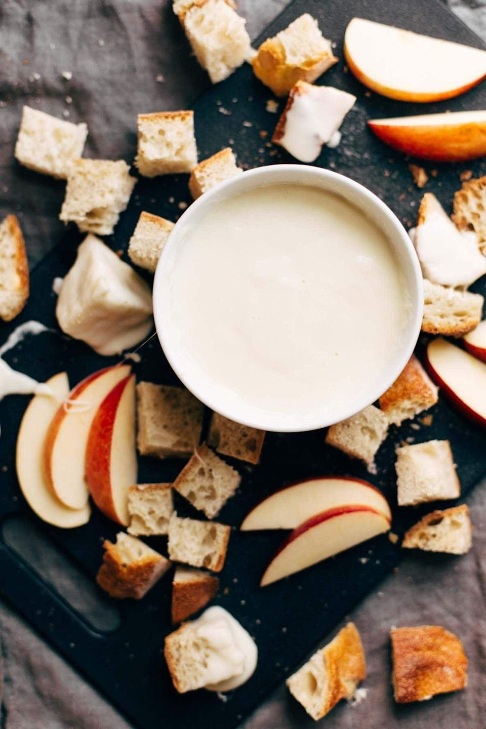 "<p>Fancy, classy, and delicious - that's exactly what this creamy fondue is. With a dash of white wine and a whole lot of Swiss cheese, this fondue will make your taste buds come to life when you enjoy it with warm French bread and crisp apples. Oh, and of course, a bottle of wine!</p> <p><strong>Get the recipe</strong>: <a href=""https://pinchofyum.com/easy-cheese-fondue"" class=""link rapid-noclick-resp"" rel=""nofollow noopener"" target=""_blank"" data-ylk=""slk:white wine and Swiss cheese fondue"">white wine and Swiss cheese fondue</a></p>"