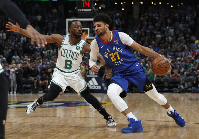 Denver Nuggets guard Jamal Murray, right, is defended by Boston Celtics guard Kemba Walker during the first half of an NBA basketball game Friday, Nov. 22, 2019, in Denver. (AP Photo/David Zalubowski)