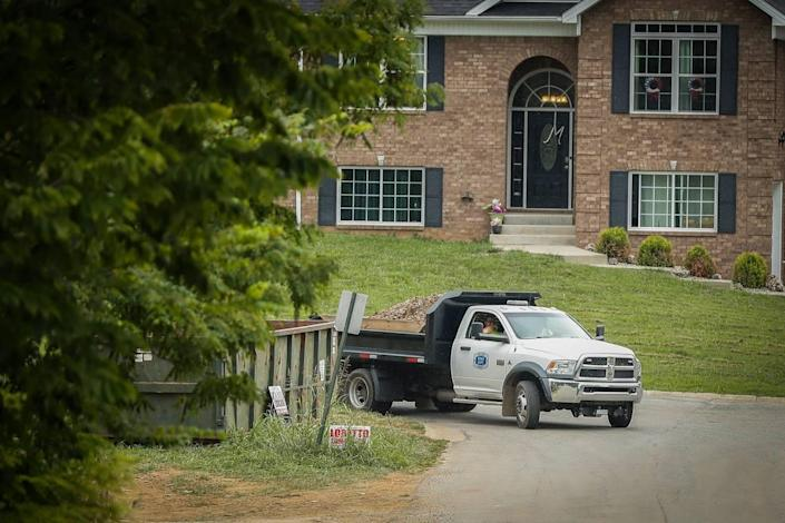 A truck carrying dirt and pieces of concrete was driven away from a property along North Howard Street as the FBI searched Wednesday for evidence in the disappearance of Crystal Rogers in Bardstown.