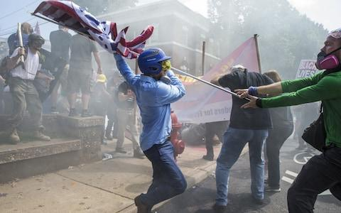 Clashes at Emancipation Park where the White Nationalists are protesting the removal of the Robert E. Lee monument in Charlottesville - Credit: Anadolu Agency/Anadolu