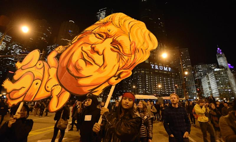 Demonstrators take part in a protest near Trump Tower in Chicago on November 9, 2016 (AFP Photo/Paul Beaty)
