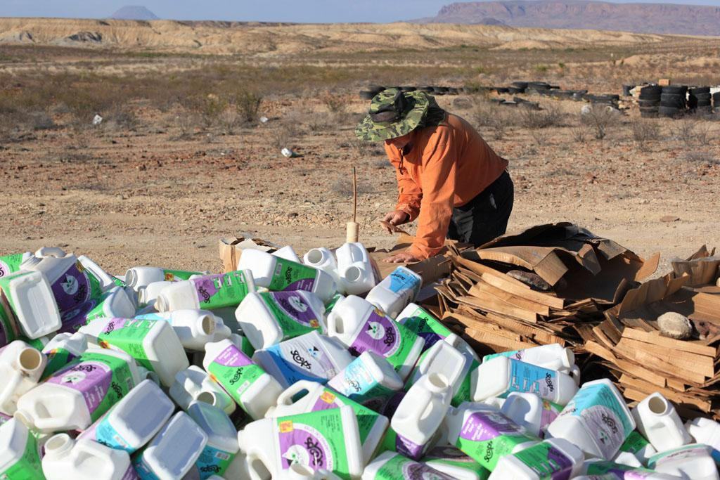 Alpine, TX, USA - Robert Earl is collecting supplies to build a home out of recyclable materials.