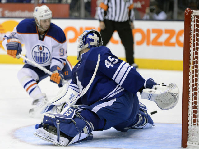 Edmonton Oilers Ryan Smyth directs the puck past Toronto Maple Leafs goaltender Jonathan Bernier during the third period of an NHL hockey game, Saturday, Oct. 12, 2013 in Toronto. (AP Photo/The Canadian Press, Frank Gunn)