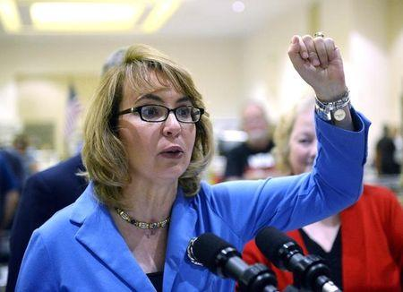 Former U.S. Rep. Giffords speaks to reporters during the New Eastcoast Arms Collectors Associates Arms Fair in Saratoga Springs