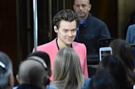 <p>Styles's shorter hair can go a variety of ways, like this slicked-back look for one.</p>