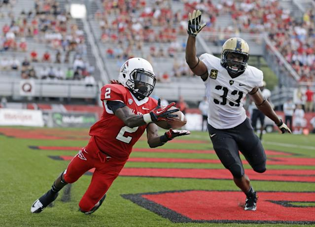 Ball State wide receiver Jamill Smith, left, makes a catch for a touchdown in front of Army linebacker Tyler McLees during the first half of an NCAA college football game in Muncie, Ind., Saturday, Sept. 7, 2013. (AP Photo/Michael Conroy)