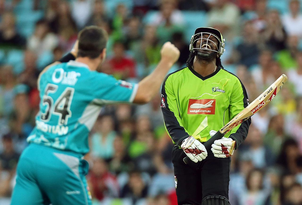 SYDNEY, AUSTRALIA - DECEMBER 28:  Chris Gayle of the Thunder looks dejected as he is dismissed by Dan Christian of the Heat during the Big Bash League match between the Sydney Thunder and the Brisbane Heat at ANZ Stadium on December 28, 2012 in Sydney, Australia.  (Photo by Mark Metcalfe/Getty Images)