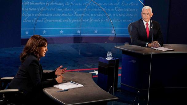 PHOTO: Vice President Mike Pence looks at Democratic vice presidential candidate Sen. Kamala Harris, as she answers a question during the vice presidential debate, Oct. 7, 2020, at the University of Utah in Salt Lake City. (Morry Gash/Pool via AP)