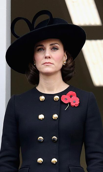 Kate Middleton dressed in black stands on the balcony to watch Remembrance Sunday service in London