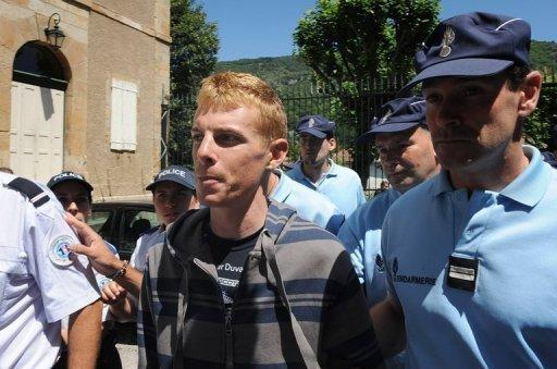 Italian cyclist Riccardo Ricco (C) pictured in 2008 being escorted by policemen in Foix, southern France