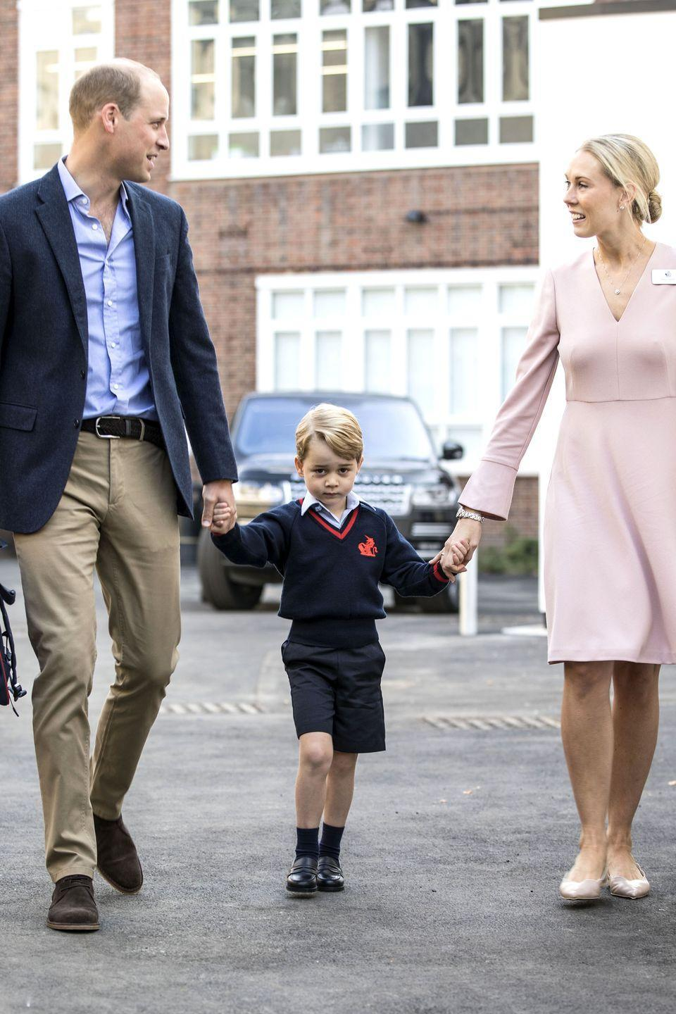 <p>Prince William walks Prince George into his new school at Thomas's Battersea, who seems to have gotten a case of the 'first day' nerves. </p>