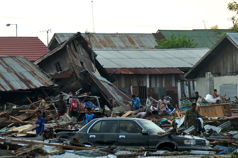 Amid Palu's levelled trees, overturned cars, concertinaed homes and flotsam tossed up to 50 metres inland, residents and rescuers struggled to come to grips with the scale of the disaster (AFP Photo/MUHAMMAD RIFKI)