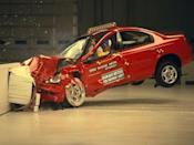 """<p>Throughout two generations and a decade of Dodge Neons, the little Plymouth scored Poor ratings during IIHS crash tests. During the debut model's crash testing, the dummy's head bottomed out on the airbag and hit the steering wheel. The second-generation Neon did worse. Excessive movement in the 40-mph test meant the dummy was able to move too far forward again, but this time the steering wheel broke loose as the impact caused movement from the dashboard. The interior photos show both the dummy's knees making contact with the bottom of the dashboard. It received a Poor rating again for side impact for models without the optional curtain airbags, as of course, the dummy's head smashed into the barrier. </p><p><a href=""""https://www.youtube.com/watch?v=Gb1XOUPcOtg"""" rel=""""nofollow noopener"""" target=""""_blank"""" data-ylk=""""slk:See the original post on Youtube"""" class=""""link rapid-noclick-resp"""">See the original post on Youtube</a></p>"""
